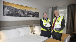 Pat McCann, chief executive of Dalata (left), with chairman John Hennessy, on a visit to the company's latest Maldron hotel, which is being built in Belfast