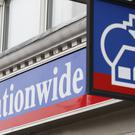 Nationwide kept its savings deposit rates higher than rivals while passing on the base rate cut to mortgage borrowers in full