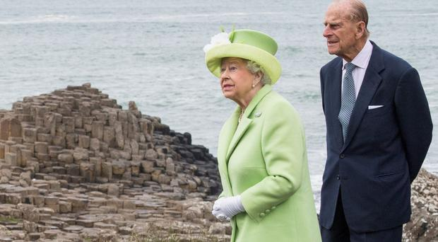 The Queen and Duke of Edinburgh on a trip to the Giant's Causeway, which saw an increase in visitors