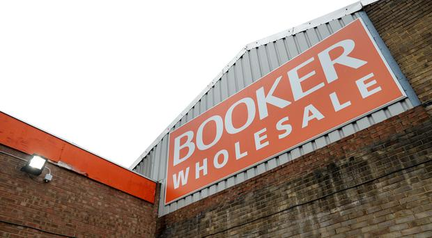 Tesco faces an investigation into its £3.7bn deal to merge with food wholesaler Booker