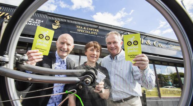 Colin Neill, chief executive of Hospitality Ulster, with Robert Bell, owner of S.D. Bells in Ballyhackamore and Pamela Grove-White from Sustrans at the launch of the cycling loyalty scheme Pedal Perks