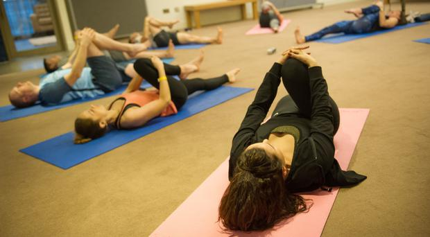 Yoga classes are among the perks firms are offering staff