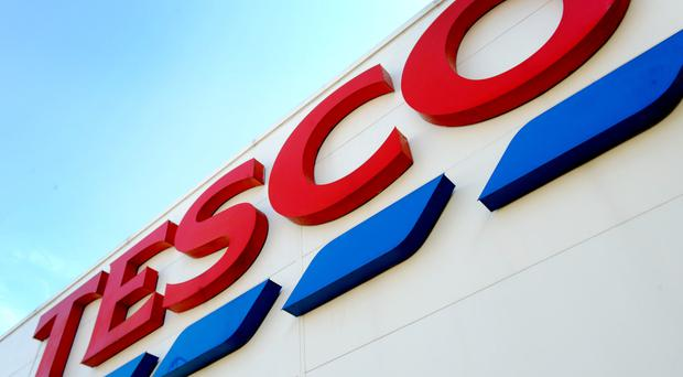 General view of Tesco shop sign in central London.