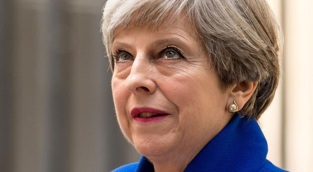 The FTSE 100 fell into the red amid uncertainty over the future of Theresa May's government