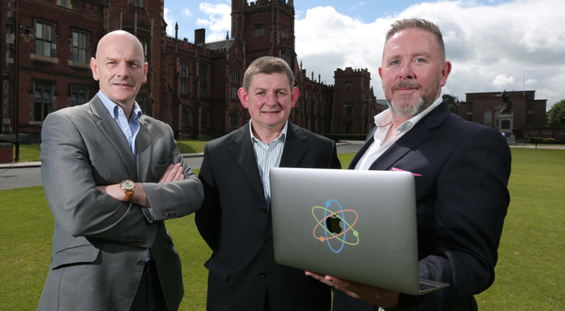 Professor Christopher Elliot, left, of Queen's University Belfast announces the partnership with Kieran Kelly, right, and Brendan Smyth of Arc-net