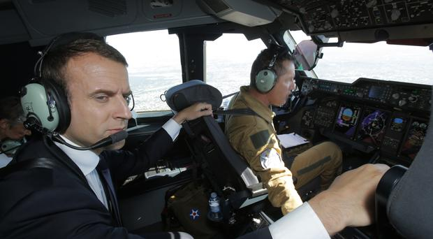 French President Emmanuel Macron in an Airbus A400M turboprop transport plane while flying to Le Bourget airport, north of Paris (Michel Euler/AP)