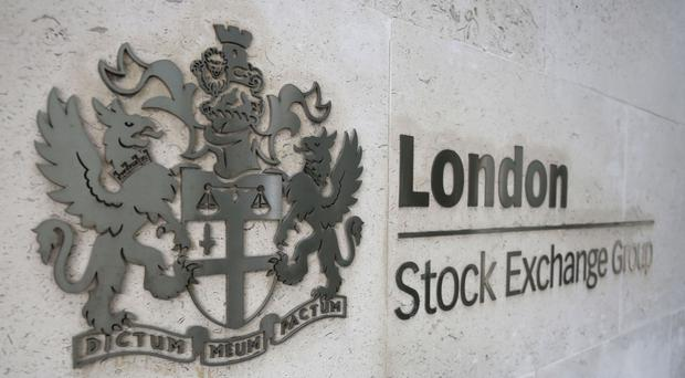 London's premier index drifted lower after research pointing to a slump in consumer confidence took its toll on blue-chip stocks.