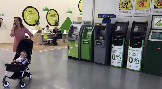 No cash here: ATMs paralysed by the cyber attack lie idle at a city supermarket in Kiev, Ukraine (AP)