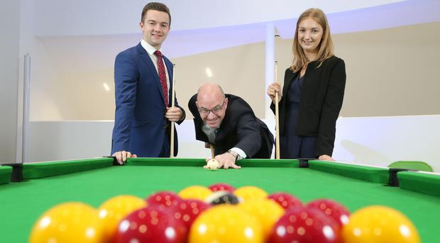 FinTrU chief executive Darragh McCarthy (centre) with firm's Michael Magennis and Claire Brennan