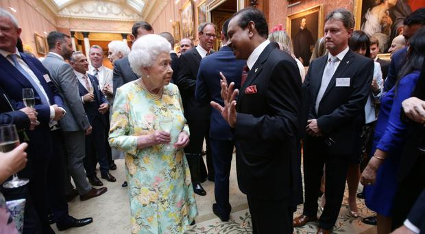 The Queen meets recipients of the The Queen's Awards for Enterprise during a reception at Buckingham Palace