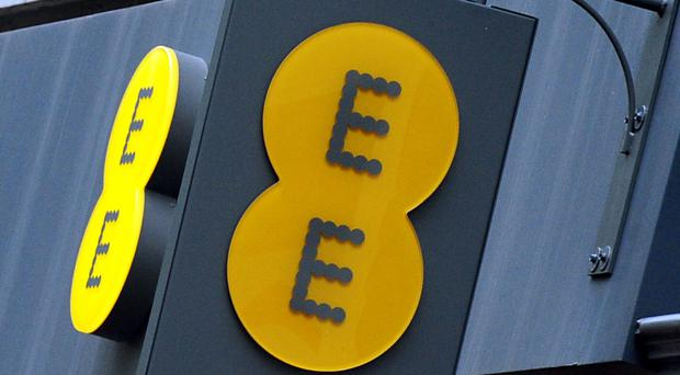 The deal will see EE open 100 'stores within stores' by 2019