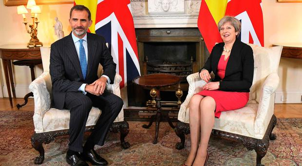 Theresa May with King Felipe of Spain. She has vowed to deliver a balanced budget by middle of next decade