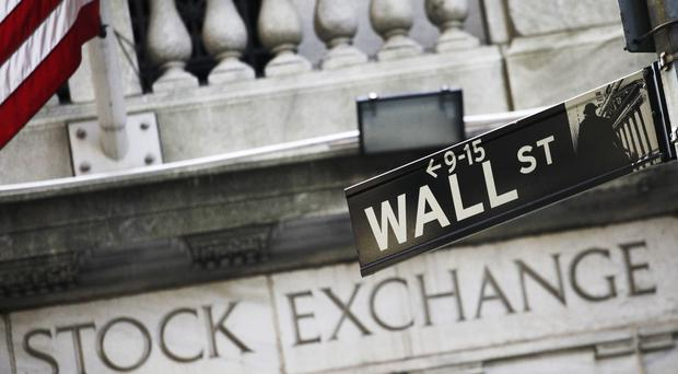 The Standard and Poor's 500 index, Dow Jones industrial average and Russell 2000 index of smaller-company stocks each set records (AP/Mark Lennihan)