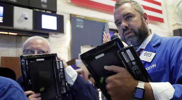 Trader Kevin Lodewick works on the floor of the New York Stock Exchange (Richard Drew/AP)
