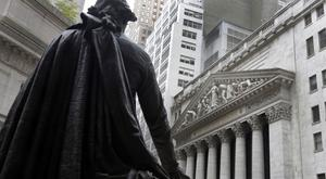 The statue of George Washington faces the facade of the New York Stock Exchange (AP/Richard Drew)