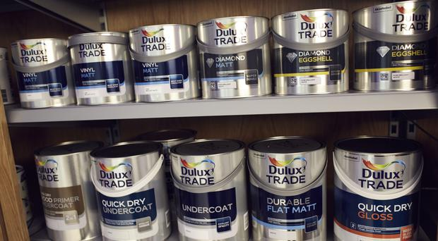 Dulux owner AkzoNobel blamed weak demand and a rise in the cost of raw materials for disappointing second-quarter core earnings