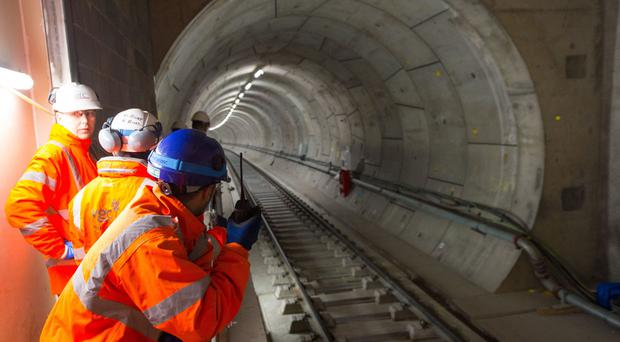 Workers at the construction site of the Paddington Crossrail station in central London