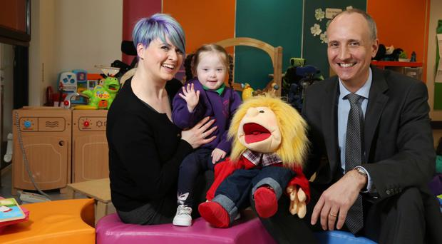Vanessa Elder, head of fundraising at Mencap NI, and Ian Sheppard, chairman of IoD NI, with three-year-old Zofia, who attends the Mencap Children's Centre