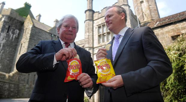Tayto chairman Raymond Hutchinson (left) and chief executive Paul Allen
