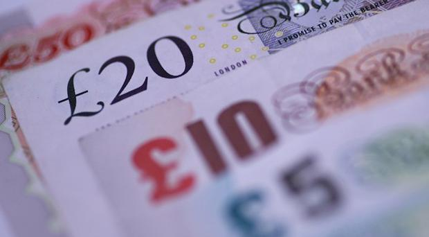 Couples raising two children while working full-time on minimum wage are falling £49 a week short of being able to provide their family with a basic, no-frills lifestyle, research has found. (stock photo)