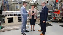 First Minister Arlene Foster at the official opening of the new manufacturing hall at Greiner Packaging in Dungannon with outgoing CEO Jarek Zasadzinski (left) and incoming CEO Philip Woolsey
