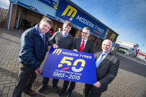 Rory and Shane Byrne, owners of Modern Tyres, celebrate the 50th anniversary of the firm with David Meade and the group's general manager, Charles Corscadden