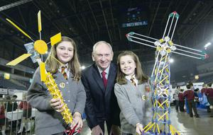 """'Northern Ireland's STEM curriculum is falling far short' – Sentinus Chairman  Young Innovators Showcase Their Work at NI's Largest Science Fair       Hundreds of young innovators from across Northern Ireland attended NI's Largest Science Fair – the Sentinus Young Innovators Exhibition –at the Odyssey Arena, Belfast today. As exemplars of what is required to drive forward a strong knowledge based economy in Northern Ireland, Sentinus Chairman, Jim Stewart expressed serious concerns about the current statutory curriculum commitment to STEM subjects suggesting that Northern Ireland is falling 'far-short of what is needed to compete with the strongest economies in the world.""""     Pictured at the Sentinus Young Innovators Exhibition at the Odyssey Arena are (l-r): Juilia Marrow and Emily Richardson from Antrim Primarcy School show of their Smart Energy project to Jim Stewart, Chairman of Sentinus.  Picture by Brian Morrison."""