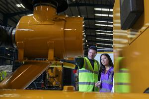 Student Angel Reyes with Danny McAllister of Caterpillar NI at the firm's Larne plant