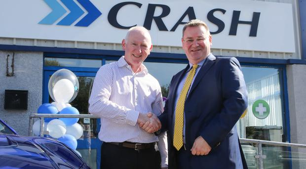 Londonderry Chamber of Commerce President Brian McGrath with Jonathan McKeown of Crash Services