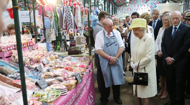 Jim Moore meets the Queen at St George's Market in Belfast in 2014