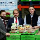 HSBC's Marty Colvin (centre) with Mash Direct's Jack and Lance Hamilton