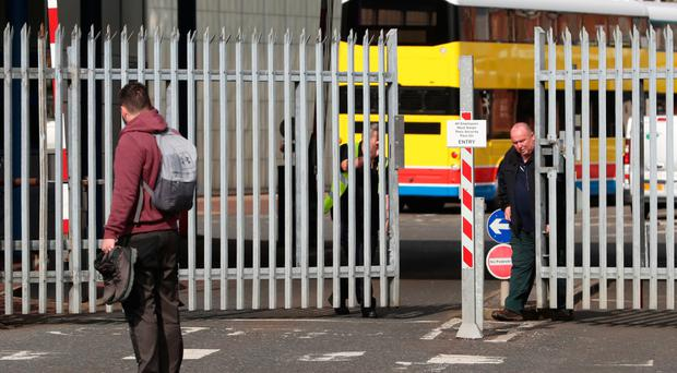 Security staff shut the gates of Wrightbus after the firm's closure last week