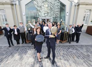 Adrian McNally, general manager, and Yvonne McIlree, director of sales and marketing, join staff at Titanic Hotel to celebrate the award