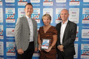 Around Noon company founder Sheila Chambers MBE with Gareth Chambers, CEO, and Howard Farquhar, Chairman collecting their Sunday Times Virgin Fast Track 100 award