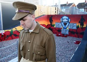 A remembrance service at the memorial at Mourneview Park