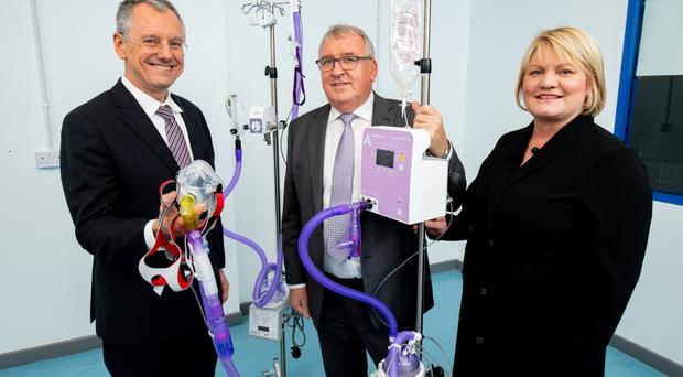 Invest Northern Ireland CEO Kevin Holland (left) with John Armstrong and Dawn Hart of Armstrong Medical