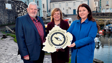 Bill Adamson, chairman of Carrickfergus Enterprise, manager Kelli Bagchus and Portia Woods, founder of Toast the Coast