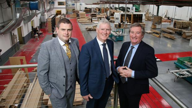From left: Ciaran and John O'Hagan from the firm with Bill Montgomery of Invest NI