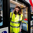 Minister for Infrastructure Nichola Mallon standing in the doorway of a Wrightbus prototype hydrogen bus