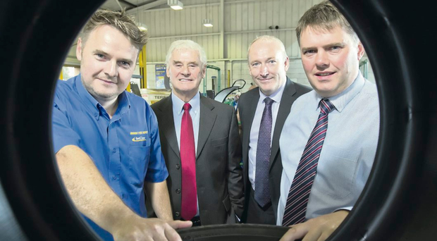 Modern Tyres founder Jimmy Byrne (second from left) with sons Rory (left), Connor (right) and Larrry Murphy of First Trust Bank