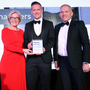 Gareth Chambers, who won Young Business Person of the Year in 2018, is presented with his award by Wendy Austin and Terry Moore, CEO of Outsource Solutions who sponsored the award