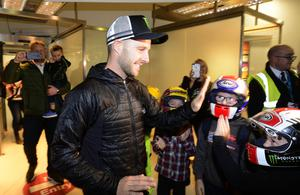 Jonathan Rea arrives at George Best Belfast City Airport where fans, friends and family, including sister Chloe, were waiting to greet the Superbike legend