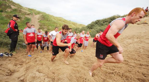 Ulster's rugby stars are put through their paces on Portstewart Strand by director of rugby Les Kiss ahead of the start of the new season