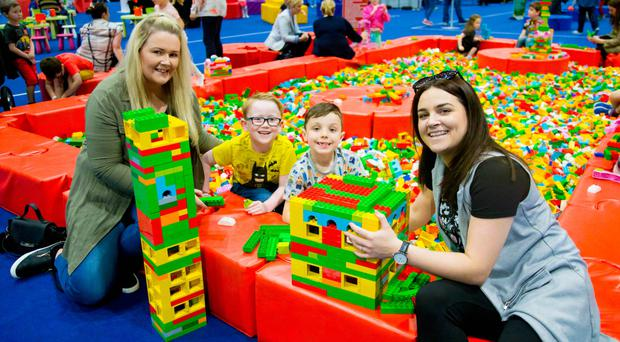 Breege Houten with son Riley and Sinead Burke with son Nathan at the Lego exhibition at the Titanic Exhibition Centre