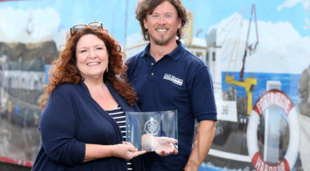 Paul Carson) managing director at Still Waters, is presented with the award by BBC radio personality Kim Lenaghan.