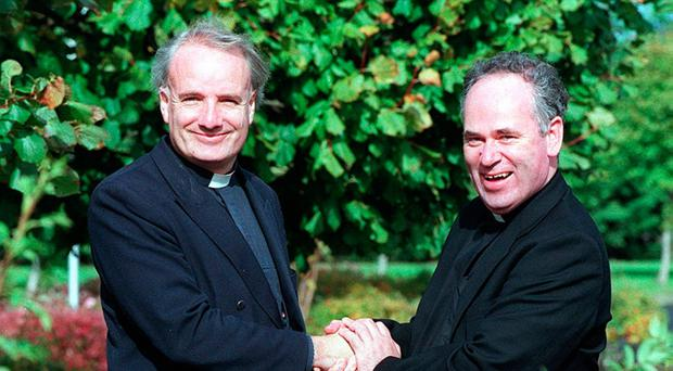 Rev David Armstrong shakes hands with Fr Kevin Mallon [File photo]
