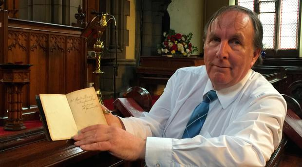 Donald Mackechnie with a 151-year-old Bible which has been returned to the Scots descendants of its original owner after making a 3,500 mile journey from the US