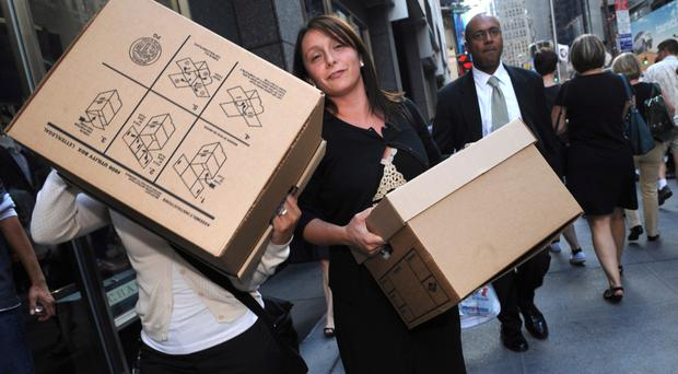 Staff at Lehman Brothers in New York clear their things after the bank sank in 2008