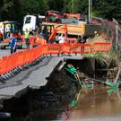 The damage in and around the River Faughan, including the collapsed bridge