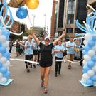 Fiona crossing the finish line on Great Victoria Street